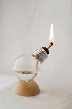 Oil lamps from lightbulbs by Recycled Light Company! Awesome!
