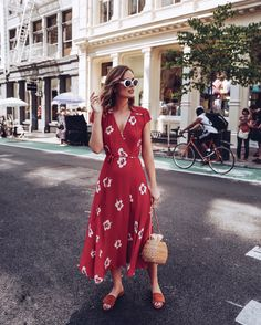 STREET STYLE: Reformation red midi dress dress with straw basket bag