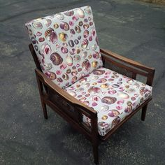 Newport shell Mid-Century Modern armchair with caned side panels
