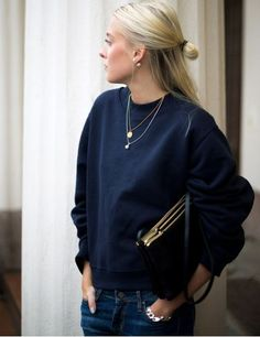Dress up a sweatshirt and jeans with simple, feminine jewelry + a structured clutch/bag