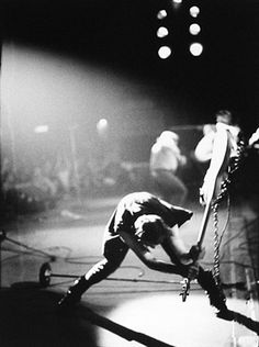 """Pennie Smith : 'Paul Simonon - The Palladium, NYC. 21st Sept 1979'. The Clash's bass player loses it at the end of a bad night and his favourite Fender Precision meets the stage. A stunning shot, which caused Q Magazine to vote it 'Best Rock Photograph of All Time'...K    PS - Even if, the focus, as my old film lecturer, Brian Wishart used to say, was, """"sharp as a tennis ball""""...."""
