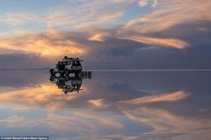 Dusk departure: Visitors spend hours at the salt flats watching the effect of the changing...