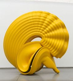 Yellow art abstract sculpture by Tony Cragg.