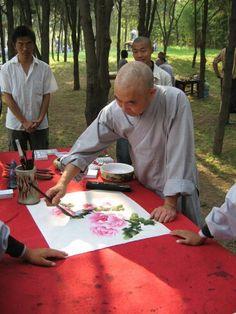Shoalin monk doing flower demonstration