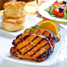 An outstanding recipe for orange glazed pork chops where the marinade does double duty by being turned into a delicious, honey citus cardamom glaze.