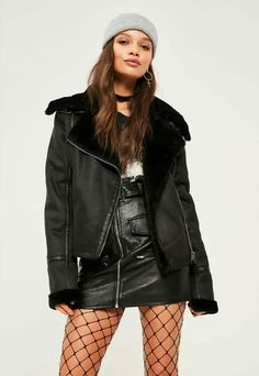 357327669fc Up your winter style and stay away from cold in this gorg black pilot  jacket. With faux fur lining