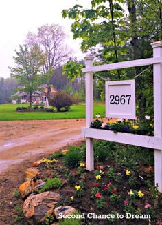 driveway entrance house number sign with planter box - Second Chance to Dream featured on @Remodelaholic