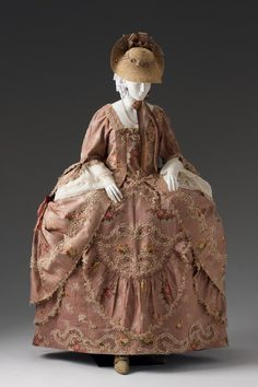 c. 1750-75.  Robe a la française dressed a la Polonaise.  The fashionable vogue of weating a robe a la francaise dressed a la Polonaise displays the overskirt of the dres tied at the sides using interior cords and/or ribbons or buttons to form three large poufs.  This style was reportedly in response to the 1772 division of Poland into three kingdoms and is called Robe a la Polonaise. Silk brocade.  Fashion- Mint Museum.org