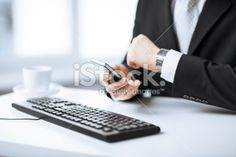 man hands with keyboard, smartphone and wristwatch Royalty Free Stock Photo