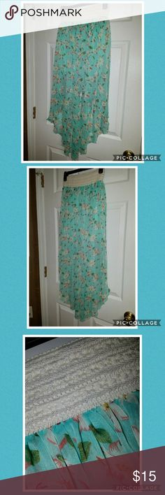 Flowery High-Low Junior Skirt Beautiful teal high-low skirt with white/pink flowers. Only worn twice so it's in great condition. BB Couture Skirts High Low
