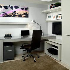 Una oficina moderna en donde el blanco de las paredes y el negro de los muebles son protagonistas