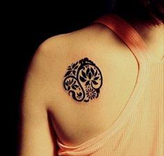 Bold Black Lotus Tattoo On Back Shoulder