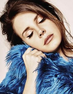 Lana Del Rey's flawless cat-eyeliner and blue fur for Grazia France // Photo: Thomas Nutzl