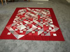 Red and Black | Flickr - Photo Sharing! Mary's triangles block with blocks set off center and someHST extending into the border.  Sally Schneider method for making Mary's Triangle block???