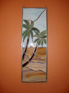 Palm trees on a sandy beach at sunset stained glass panel wall hanging. $95.00, via Etsy.