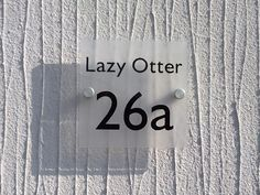 "Ever thought of giving your home a name? Like this Cool House Name Plate ""Lazy Otter"" ❤️www.de-signage.com signs for houses - When only Something Special will do"
