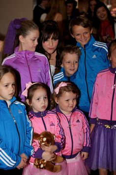 The flower girls in Adidas track tops and tutus, and the page boys in Adidas tops. Back row - Jade, Christie, Josiah, Nathan. Front row - Amber, Tahlia, Georgie, Tyla