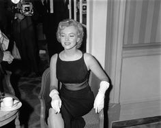 Marilyn at a Press Conference at the Savoy Hotel in London to publicise her forthcoming film The Prince And The Showgirl, 1956.