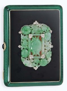 AN ART DECO GEM-SET AND ENAMEL CIGARETTE CASE, BY TIFFANY & CO. The openwork…