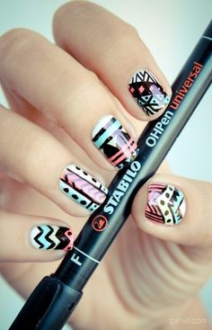 Tribal print nail art, apparently done with permanent pen; pretty smart idea, easier to work with than a paint brush.