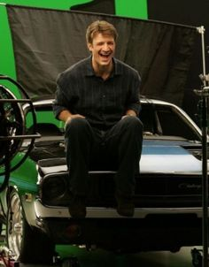 Nathan Fillion on a 1967 Chevy Impala.<< I agree that it's perfect that he's on an amazingly cool muscle car but that is a Dodge Challenger, if you could take a moment to read the LABEL ON THE GRILL OF THE CAR. Dear Nathan, Nathan Fillon, 1967 Chevy Impala, Malcolm Reynolds, Castle Tv Shows, Abc Tv Shows, Best Muscle Cars, Stana Katic, Man Alive