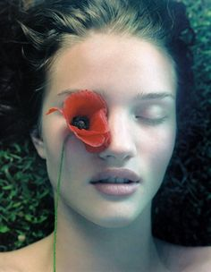Rosie Huntington-Whiteley gets in tune with nature for this 2006 spread from Vogue China. Photographer Sophie Delaporte captures as Rosie delves into a field of flowers, climbs trees and relaxes in the summer sun.