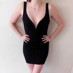 Windsor Deep Plunge LBD In excellent-like new condition, worn once. The perfect LBD! Has a deep plunge in the front that's boned to keep its shape. Every girl needs a little black dress in her closet! The material is 'ribbed' looking, and has a hidden zipper up the back. Smoke/pet free home. Ask all questions before buying  NO trades❌ Bundle for a discount WINDSOR Dresses Mini