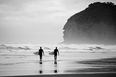 Surfers on Piha Beach : Just a scene from inception. Check this out http://www.globalfootprints.co.uk