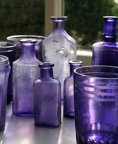 Bedroom decor inspiration- vintage bottles in purple