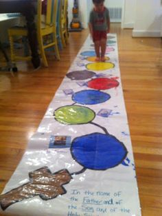 Rosary Hopscotch. Walking a decade of the rosary with kids- this is so cute! I've been thinking about something like this with paper plates for years, but here it is- a reality! :-)
