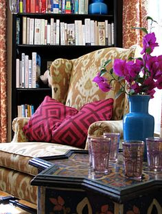 What a great place to read! The mix of styles, patterns and colors is really inspired.~s