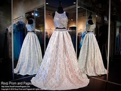Step up your fashion game in this dazzling two piece ball gown. Its embellished silver crop top is complimented with a fabulous full skirt... Own it and it's at Rsvp Prom and Pageant, your source for the HOTTEST Prom and Pageant Dresses!