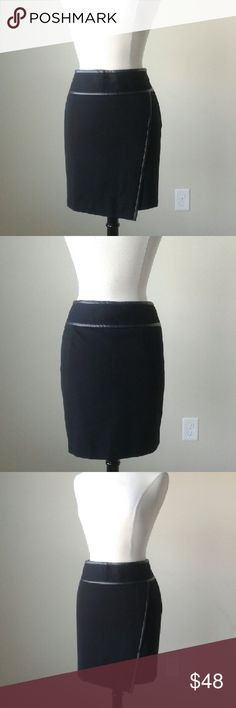 Wrapped black mini skirt -Ponte knit fabric -Shell: 70% rayon, 25% nylon, 5% spandex -Faux wrapped front -Invisible side zip -Fully lined -waist 34.5 inches, hip 42 inches, length 18.75 inches White House Black Market Skirts Mini