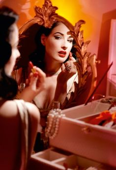 Dita Von Teese  The mistress of eccentric glamour Dita Von Teese shares her tips on perfect look - lips, eye brows, beauty spot and cats-eyes, for New Year's Eve