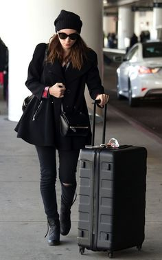 LE FASHION BLOG AIRPORT LOOK ROONEY MARA BLACK AND PLAID BLACK ON BLACK CASUAL LOOK BEANIE HAT CAT EYE SUNGLASSES FULL SKATER COAT GIVENCHY ...