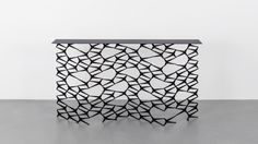 Shown in blackened steel, 68x11 x 37H DESCRIPTION The Fenced-In Console is made from repurposed cast-iron fence pieces in a traditional Art Deco repeat design. Originally inspired by the ornate iron work common on Brooklyn brownstones in neighborhoods surrounding the Uhuru workshop, the Fenced-In Consolemakes a striking entryway or reception room centerpiece. Available in custom …