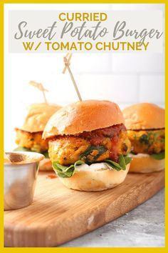 You're going to love this Vegan Sweet Potato Burger. They are made with a curried spiced sweet potato patty that is filled with veggies and herbs. The patty is served with cilantro aioli and tomato chutney for a hearty and healthy burger. #curriedsweetpotato #sweetpotatoburger #veganburger #mydarlingvegan