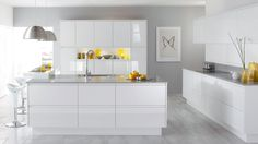Handleless Gloss White Kitchen. Modern Look. Great for a studio flat where kitchen is open to bedroom.
