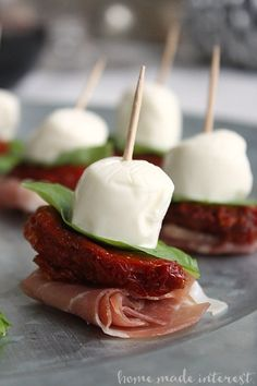 Mozzarella, basil, sundried tomatoes and prosciutto