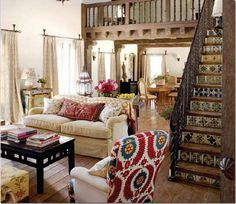 I like the mix of patterns with solid furniture Fun arm chair and then the simple couch and cute pillows
