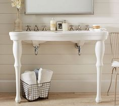 Parisian Pedestal Double Sink Console #potterybarn---LOVE this for small spaces.  Put some baskets underneath to hold your STUFF
