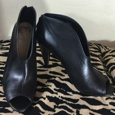 "Vince Camuto New With TagsBlack Leather Booties Vince Camuto BRAND NEW With Tags Black Leather Booties  Gorgeous Leather Peep Toe Booties,  Padded Footbed .. Stunning Tapered 4"" Heel and Back zipper!  Vince Camuto Shoes Ankle Boots & Booties"