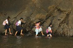 A woman accompanies some students as they wade in the shallow part of a rocky beach to their school to attend the first day of classes in Sitio Kinabuksan, Kawag village, Subic, Zambales Province, north of Manila June Walk To School, Public School, Schools Around The World, Around The Worlds, First Day Of Class, Women In Leadership, Free Education, Thinking Day, School Pictures