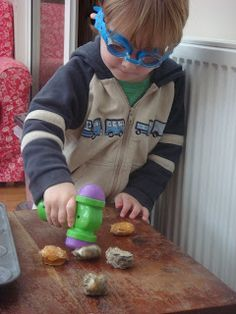 Bashing baked cotton balls – great idea for little boys with a tonne of energy
