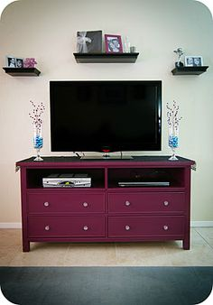 from dresser to TV stand...LOVE this idea and then you could put movies in the other drawers - black with crystal knobs would be beautiful