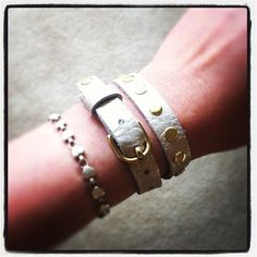 White gold metallic leather wrap bracelet with gold hardware