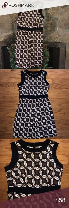 "🍰TALBOTS🍰PINWHEEL PRINTED DRESS🍰 This is a beautiful Talbots dress typical of this particular brand a lot of nice details colors include brown black white. Back zipping. Black trim with black band around the waist to break up some of the print and act as a place to defined waistline. There is a flat front pleat just one again for definition of shape. 96% polyester 4% spandex. Bust 22"", waist 18"", hips 24"" and length 42"" Talbots Dresses Midi"