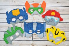 This listing is for 1 or set of all Rescue bots. These are made with acrylic and wool felt. They come with elastic attached for easy use. Great for