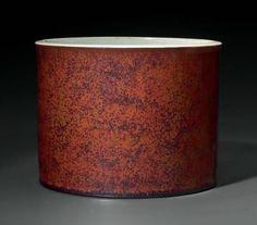 An iron-rust-glazed, cylindrical brush pot, China, Qing dynasty, 18th century