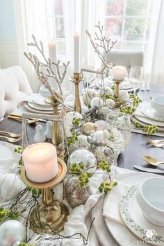 Christmas tablescape: ivory scarf, mossy twigs, ornaments, candles and reindeer. Easy but elegant!